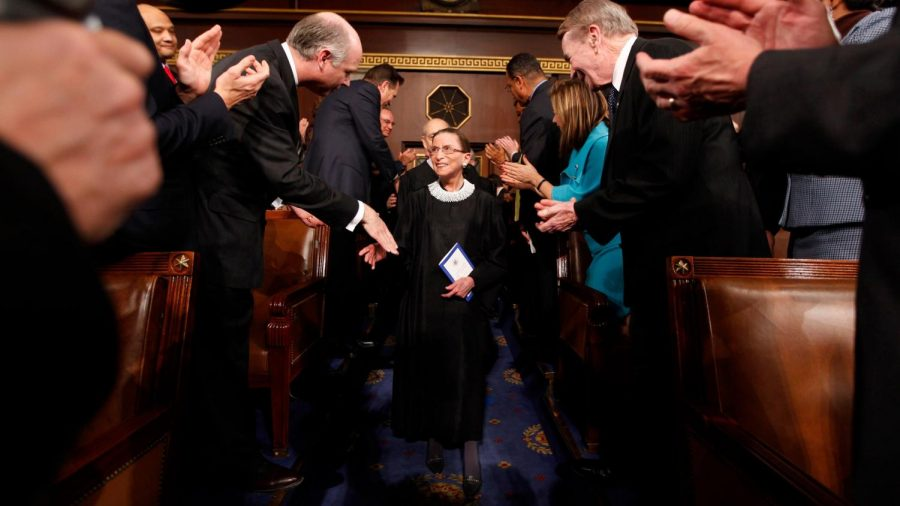 Supreme Court Justice Ruth Bader Ginsburg returning to her bench after missing a day at the court.