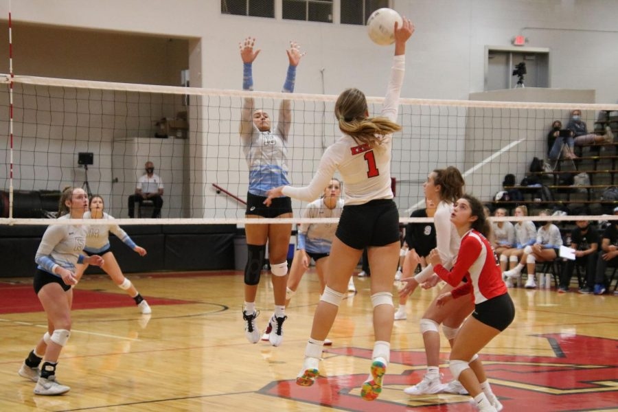 Senior Laure Roskein spikes the ball over the net.