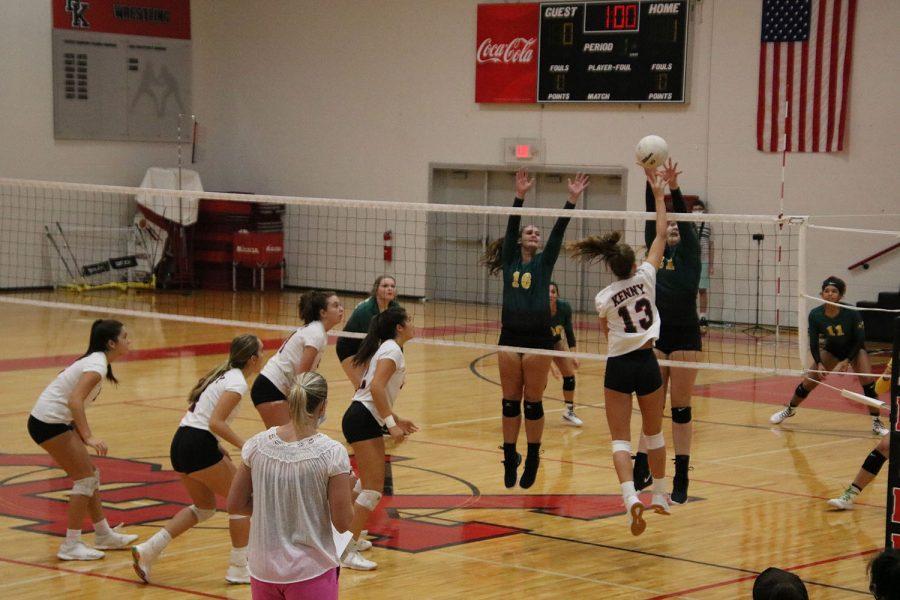 Senior Ashton Dilts tips the ball over the net.