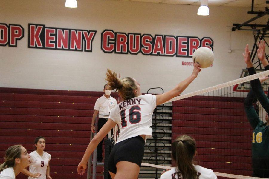 Sophomore Allison Cavanaugh tips the ball over the net.