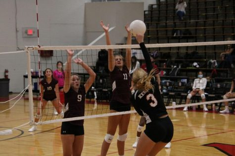 Freshman Cami Laybak bumps the ball over the net.