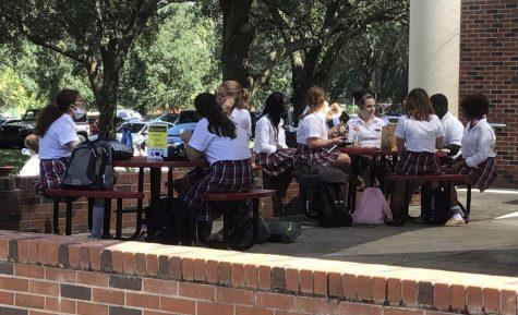 """Fewer juniors and senior sit on the """"Junior-Senior"""" patio."""