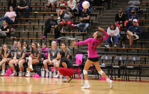 Sophomore Sarah Seabrooke spikes the ball in the first set of the match.