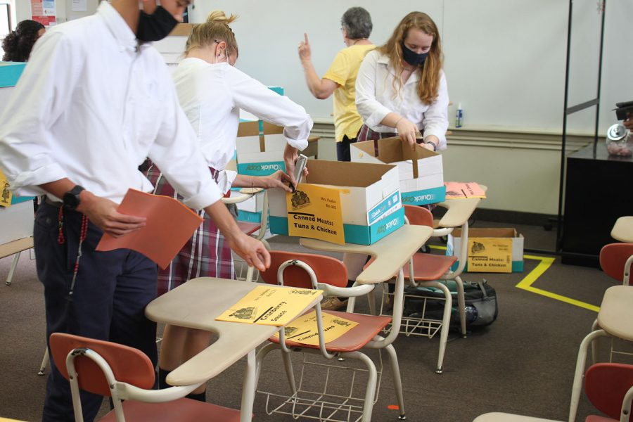 Students in St. Vincent de Paul Society help to get boxes ready for the Thanksgiving food drive.