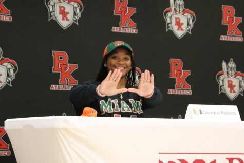 Senior Jasmyne Roberts poses to represent University of Miami after signing her letter of intent.