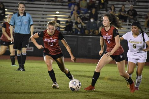 Senior Chloe Shaw and junior Victoria Rojas attacking the ball trying to defend goal from being scored on by Knights.