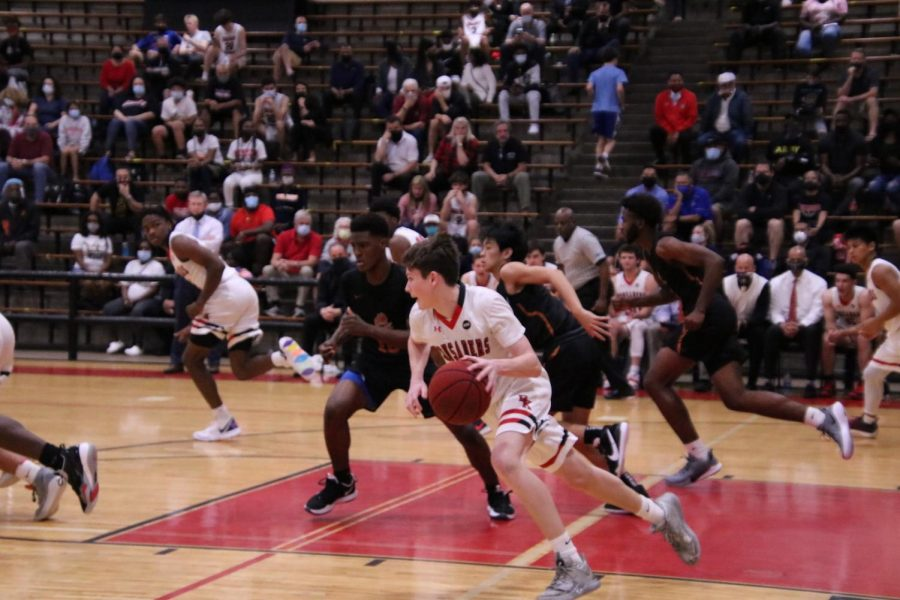 Senior Daniel Buckley dribbles the ball to the other side of the court in an attempt to make a basket.