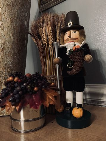 A Thanksgiving nutcracker with some extra fall decor.