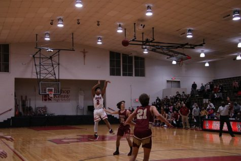 Senior Stevie Dionisio shoots and makes a three pointer.