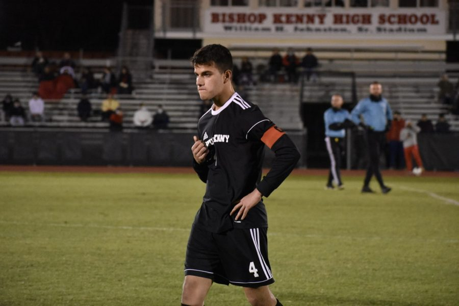 Junior captain Jaden Cortez walking off the field for a water break.