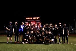 Crusaders boys soccer team including coaches and managers posing in front of their 3-0 win.