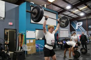 Junior Baylor Newsom completing the Jerk portion of the Clean and Jerk lift.