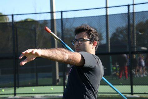 Senior Nick Rukab preparing to throw the javelin across the field during practice.
