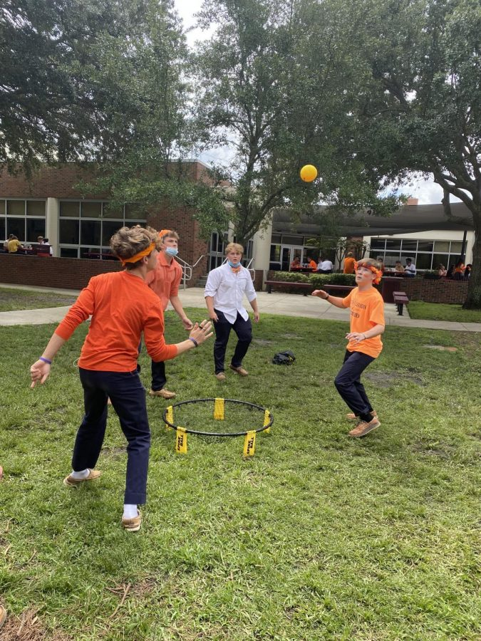 The sophomore boys play spike ball on color your class day.