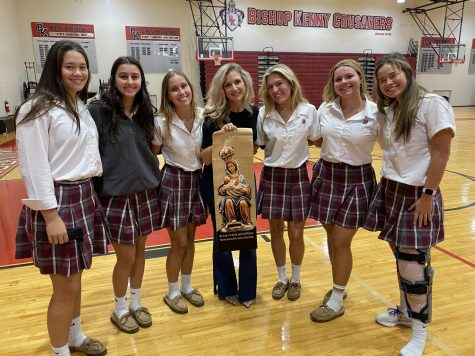Senior girls posing with Sarah Swafford after conversing with her about thr affectiveness of her assembly