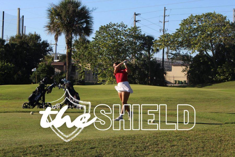 Senior Emily Williams tees off on hole two.